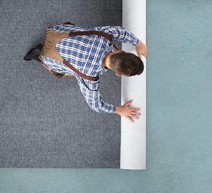 Carpet rolling for installation | Atlanta Flooring Design Centers Inc